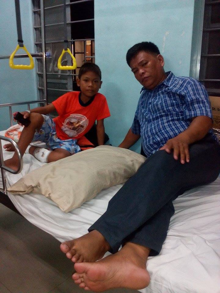 Jemar and Pastor Roy Malpas in the hospital